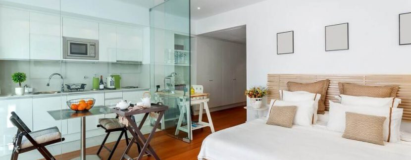 decoração-apartamento-pequeno-com-ambientes-integrados-por-paredes-de-vidro